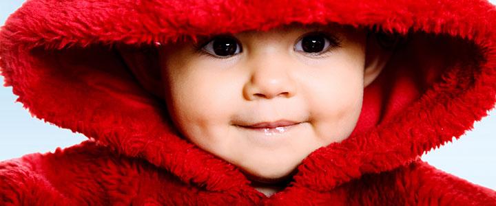 baby in red coat