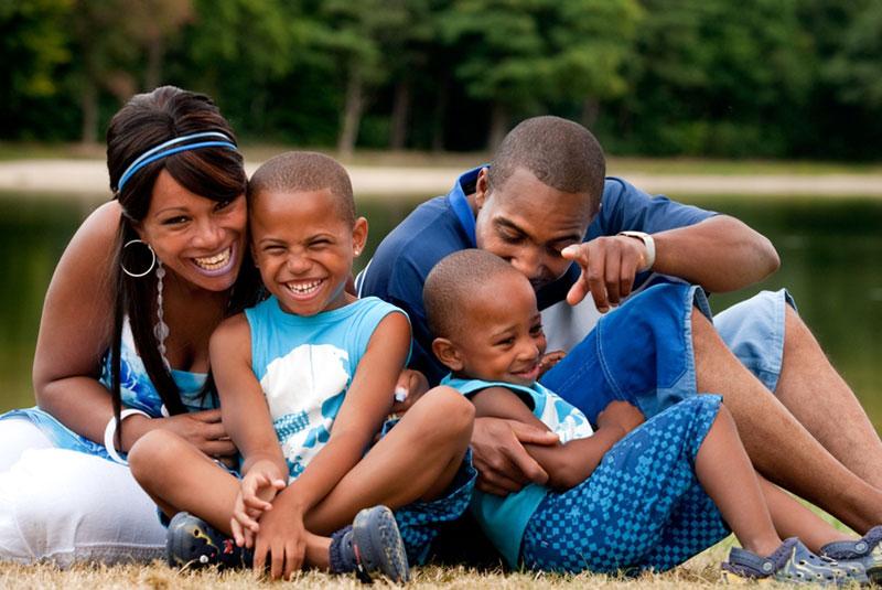 family by a pond